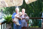 Gary and Judy Smith with their pets, Dolly and Samantha, at their home in Sunrise Beach MO.