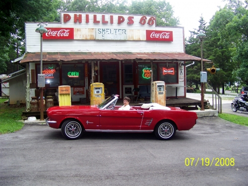 Leon Phillips's car infront of redone Phillips 66 Station