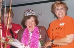 4th grade teacher crowned and presented lei and roses.  We also gave her a photo album with all 9 grades.    Jean Wehrma