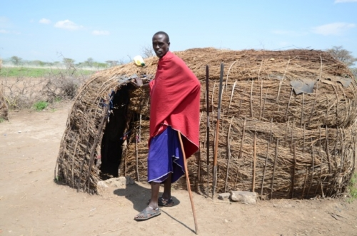 A Masai tribesman in front of his house.